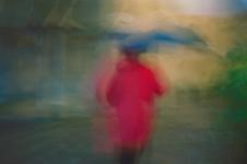 woman in rain - honfleur, normandy, france